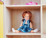 Doll on a shelf Royalty Free Stock Photos