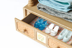 Doll shoes. A collection of doll shoes in a drawer. Focus on the blue shoes stock image