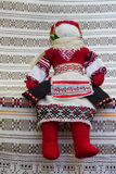 Doll sits. Handmade doll in the Ukrainian national clothes Stock Image