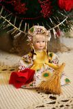 Doll sitting with a broom and dustrag. Royalty Free Stock Photo