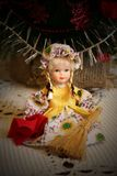Doll sitting with a broom and dustrag. Stock Photos