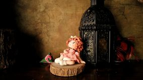 Doll is sitting on the wood with a lamp Stock Photo