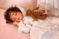 Doll Sleeping with Teddy Bear. Handmade doll sleeping with teddy bear stock photo