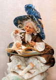 Doll Sorceress. Reading magic book, making magic or witchcraft and evoking dream stock photography