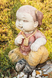 Doll Statue Smile in sitting position Stock Images