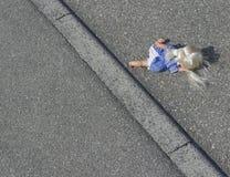 Doll on the street Stock Photos