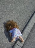 Doll on the street Stock Photo
