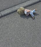 Doll on the street Stock Photos
