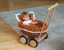 Doll stroller. Is made of wood Stock Photo