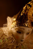 Doll study 05. Shy doll with gold hat and room for copy Stock Photography
