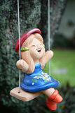 Doll on swing. Cute doll on funnt swing Royalty Free Stock Photography