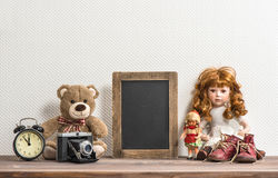 Doll, Teddy Bear, chalkboard and vintage toys Royalty Free Stock Images