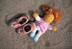 Doll and tennis shoes Stock Photography
