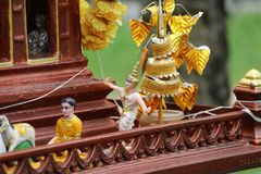 The doll of Thai folk dancer on the spirit house. Thai ghost house in brown color stock image