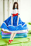 Doll tilde in a bright colored clothing Royalty Free Stock Photo