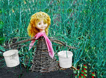 Doll, toy,  scarecrow, stands  in the garden Royalty Free Stock Photo