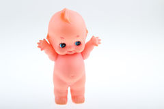 A doll toy. White background a naked pink dolls Royalty Free Stock Photography
