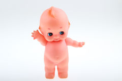 A doll toy. White background a naked pink dolls Royalty Free Stock Photos