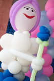 Doll twisted balloons Stock Image