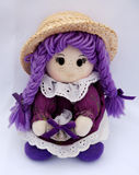 Doll in violet Stock Photography