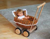 Doll wandelwagen Stock Foto