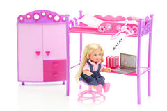 Doll, wardrobe , bed, chair and laptop Stock Photo