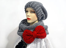 Doll wearing a crochet grey scarf and a beanie Royalty Free Stock Photography