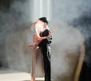 Doll wedding couple indoors is hugging each other. Beautiful model girl in white dress. Man in suit. Wedding love concept. Close u Stock Image