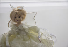 Doll in white dress Royalty Free Stock Images