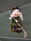 Doll Witch (Baba Yaga) with a broom Stock Images