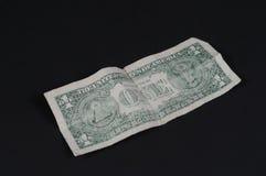 Dollar. Isolated on black backdrop Stock Image