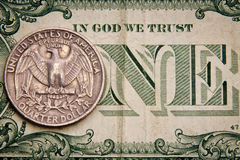 Dollar. Close-up of quarter dollar coin on the one dollar bill Royalty Free Stock Photography