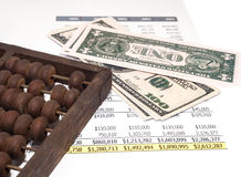 Dollar and abacus Stock Image
