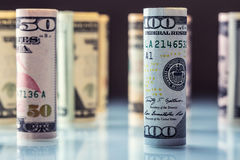 Dollar. American dollar banknotes rolled in different positions.  Stock Photos