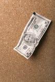 Dollar angebracht zu einem hölzernen Vorstand Lizenzfreie Stockbilder