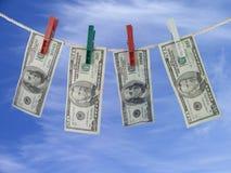 Dollar auf dem Seil Stockbild
