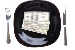 Dollar auf der schwarzen Platte Stockfotografie