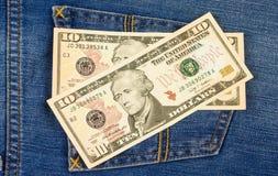 Dollar auf Jeanstasche Lizenzfreie Stockbilder