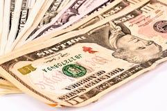 Dollar auf Weiß Stockfotos