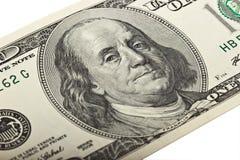 100 Dollar auf weißem Hintergrund fragment Stockfotografie