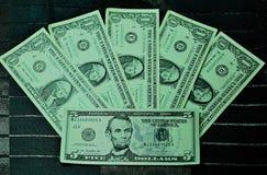 Dollar av en fem en fem Arkivfoto