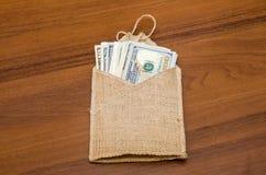 Dollar av olika värden i säck Royaltyfria Bilder