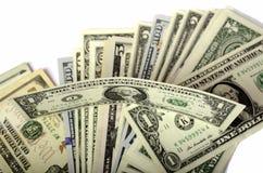 Dollar av olika valörer på vit bakgrund Fotografering för Bildbyråer