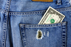 Dollar in the back pocket of jeans Stock Photos