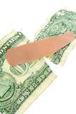 Dollar and bandage Stock Image