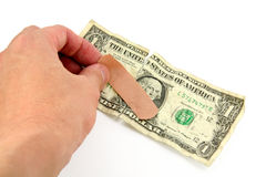 Dollar and bandage Royalty Free Stock Images