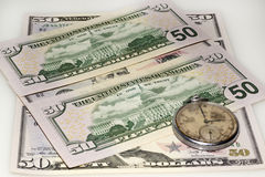 Dollar bank bills and old watch Stock Images
