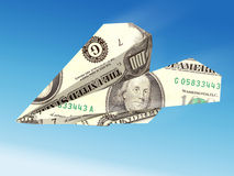 Dollar banknote airplane. On blue sky stock illustration