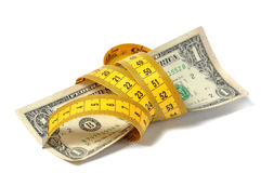 Dollar Banknote And Measure Tape Royalty Free Stock Photos