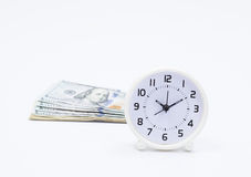 Dollar banknote and clock Stock Photo